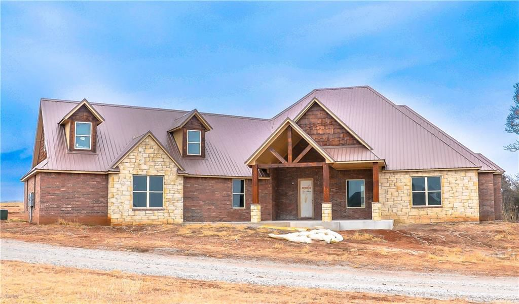 BEAUTIFUL mixture of rustic and modern, this home on 2.5 acres with pond has est. completion date of May, 2018. Open plan is perfect and features so many extras. Enter from the oversized three-car garage to a mudroom/utility and on into the optional double master/split plan with full bath. Family room/kitchen area boasts two dining areas or could be additional living area. High ceilings, 8 foot doors in every room. Bright open kitchen with giant granite center island, KitchenAid appliances and big windows to the back porch. Outdoor kitchen and back porch will be perfect this summer. Large study or opt bedroom. Upstairs bonus room/man cave/media has an addi'l 400' behind it optional to be built out (not included in square footage). Beautiful, clean white woodwork throughout with shiplap accent in breakfast area. Geothermal and spray foam insulation - you'll be saving dollars with this house. Buyer to verify all information. Plans available upon request. One year builder warranty.