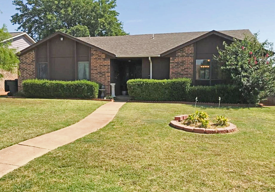 """Hurry and See! This 3 Bed/2 Bath/2 car is being sold """"AS IS"""" but priced accordingly! Cute, quiet neighborhood has Dallas-style back street garages. Open floor plan with living room, beautiful fireplace, dining room and kitchen. Breakfast bar with utility right off kitchen. Spacious master bedroom will hold king bed with large closet and full bathroom. Two nice size bedrooms near hallway bath. Side patio with ceiling fan, great for grilling. Backyard has wisteria covered pergola with wooden privacy fence. Home needs some foundation repairs (estimates received), tub needs replacing, shower needs new grout and entry needs some new siding. Conveniently located near shopping, restaurants and entertainment with easy access to Kilpatrick Turnpike. Make an OFFER! Buyer to verify all info."""